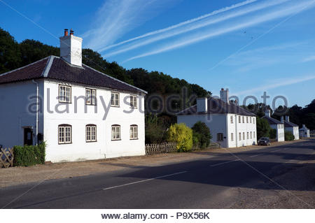 Houses (built in year 1729) in The Street, outside Houghton Hall, in Houghton, Norfolk, UK. - Stock Image