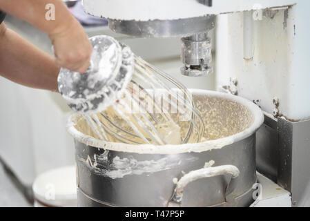 kneading dough in bakery dough mixer machine . - Stock Image
