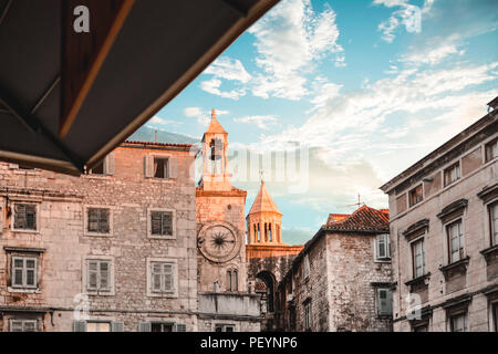 The bell and cathedral towers reflect the sun on a summer morning on People's Square at Diocletian's Palace in Split Croatia - Stock Image