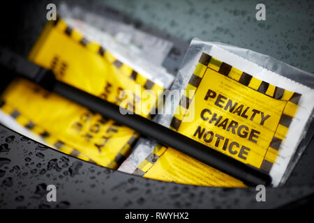 Council issued Penalty charge notices parking fines placed on a car windscreen - Stock Image