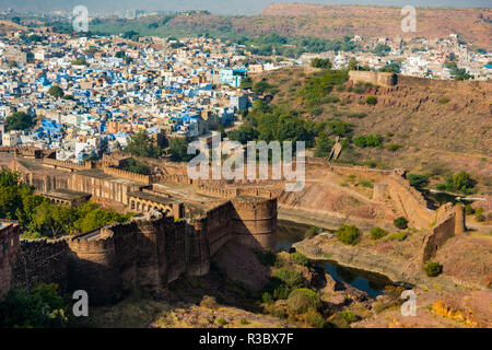 India, Rajasthan, Jodhpur. No Water No Life expedition, Mehrangarh Fort, view from tower of old city wall and houses beyond painted in indigo blue - Stock Image