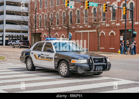 Black and white Ford Crown Victoria police car or cruiser or patrol car of Montgomery Alabama Police Department in the USA. - Stock Image