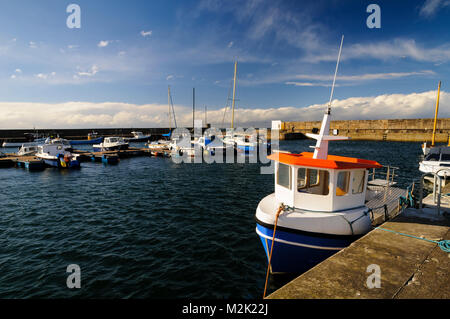 A view of boats in the harbour at Hopeman, Morayshire, Scotland. March. - Stock Image