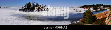 Panoramic view of frozen Georgian Bay from Chikanishing Trail in Killarney Provincial Park of Ontario in early spring - Stock Image