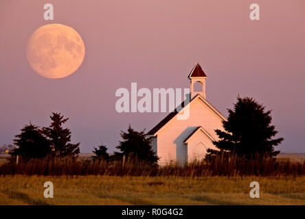 Old Country Church in Saskatchewan full harvest moon - Stock Image