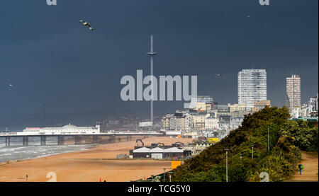 Brighton, UK. 8th June 2019.  Dark clouds provide a gloomy backdrop to Brighton seafront and the British Airways i360 observation tower today as Storm Miguel passes through Britain bringing wet and windy conditions . Credit: Simon Dack / Alamy Live News - Stock Image