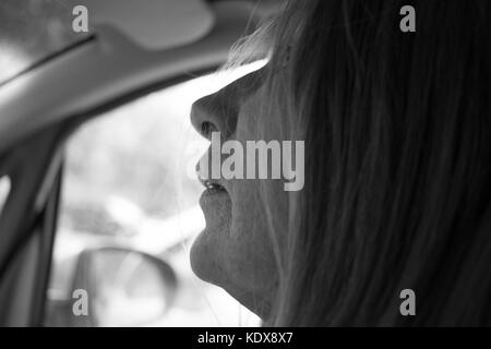 Black and white picture of a modern woman driving - Stock Image
