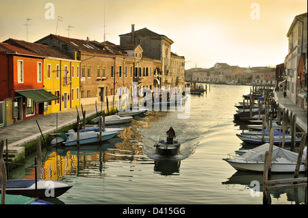 Evening canal in Murano with boats, island near Venice, Italy - Stock Image