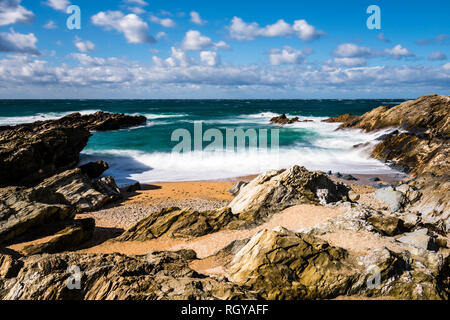 Long exposure of waves and surf in a cove at Fistral Beach, Newquay, Cornwall, UK - Stock Image