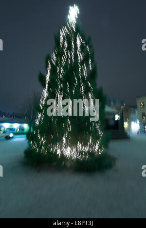 Christmas tree decorated with fairy lights, blurred - Stock Image