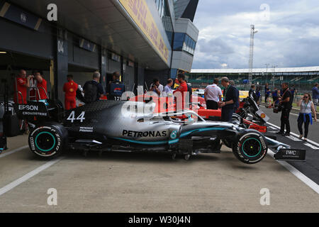 Silverstone, Northampton, UK. 11th July 2019. F1 Grand Prix of Great Britain, Driver arrivals day; Mercedes AMG Petronas Motorsport, Lewis Hamilton car waits outside of the FIA garage for checks Credit: Action Plus Sports Images/Alamy Live News - Stock Image
