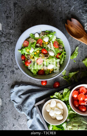 Easy to make healthy salad with baked artichoke, Mozzarella, tomatoes and corn - Stock Image