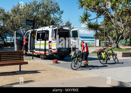 Surfers Paradise, Gold Coast, Australia, The Queensland Ambulance Bicycle Response Team began in November and sees cyclists hit the pavement to pedal  - Stock Image