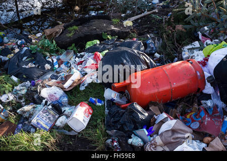 Fly tipping rubbish dumped in the countryside - Stock Image