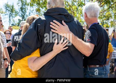 U.S President Donald Trump embraces victims of Hurricane Florence at the Temple Baptist Church September 19, 2018 in New Bern, North Carolina. Florence dumped record amounts of rainfall along the North & South Carolina coast causing widespread flooding. - Stock Image