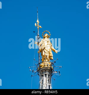 Square view of the Madonna statue on top of the Duomo di Milano in Milan, Italy. - Stock Image