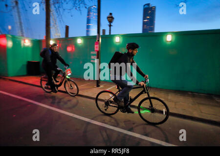 Cycling on cycle route in City of London, England, UK - Stock Image