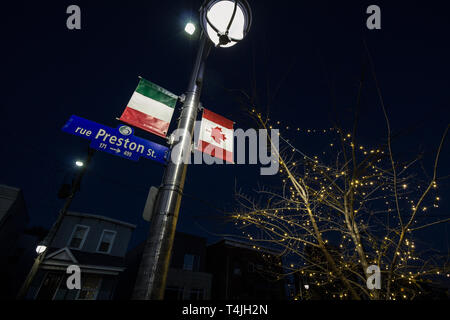 OTTAWA, CANADA - NOVEMBER 12, 2018: Italian and Canadian flags on display on preston Street in Little Italy, the italian district of ottawa, the capit - Stock Image
