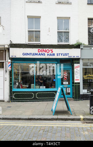Dino's Gentleman's Hair Stylist shop front in Fulham, London, UK - Stock Image