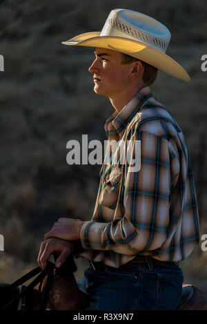 USA, California, Parkfield, V6 Ranch portrait of rider on a horse (MR) - Stock Image