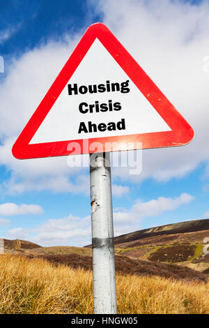 Housing crisis ahead concept sign UK housing crisis shortage of houses expensive houses mortgages rent causing problems - Stock Image