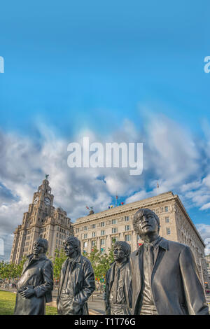 The Beatles,Statue,Pier Head,Liver Building,Liverpool Waterfront,Liverpool,Lancashire,England,UK - Stock Image