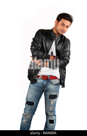 A handsome Indian teenage boy posing on a whit studio background. - Stock Image