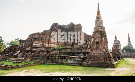 Ancient ruins of pagoda under sun light at Wat Phra Mahathat temple is a famous attractions in Phra Nakhon Si Ayutthaya - Stock Image