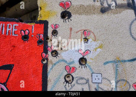 Wall art in Mostar, where the painter used bullet and shrapnel holes as part of design.  Bullet holes used as body of bugs - Stock Image