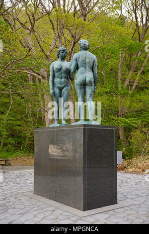 Statue of Two Maidens (also known as statue of Otome) by Kotaro Takamura in Towada Lake, Aomori Prefecture, Japan. The bronze statue depicts two nude - Stock Image