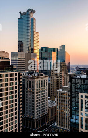 The Capella Tower stands tall above the older Soo Line Building and Rand Tower in Minneapolis, Minnesota. - Stock Image