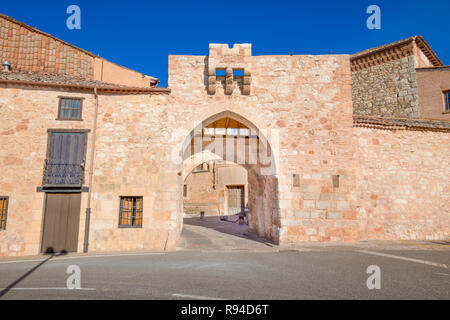 exterior medieval arch in public street, ancient gate and main access to old town, famous landmark and monument in Ayllon village, Segovia, Spain, Eur - Stock Image
