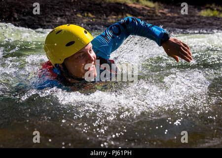 United States Marine Corporal Richard Hartzell swims through rapids on the Tully River during water negotiation training as part of Exercise Kowari 2018. - Stock Image