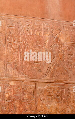 A photograph taken of the Red Chapel of Hatshepsut (the Chapelle Rouge) constructed initially as a barque shrine during the reign of Hatshepsut, the fifth pharaoh of the eighteenth dynasty of Ancient Egypt and ruled from approximately 1479 to 1458 BC. Although it had been demolished and parts were reused in antiquity, following rediscovery, the chapel has been reconstructed using its original materials. Its original location is thought to have been in the central court of the temple of Amun at Karnak, near Thebes. - Stock Image