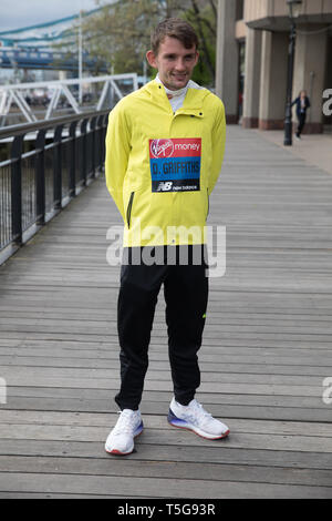 London, UK. 24th Apr, 2019. The London Marathon British Athletes Photocall takes place outside the Tower Hotel with Tower Bridge in the background ahead of the Marathon on Sunday. Taking part are: Callum Hawkins, Dewi Griffiths, Charlotte Purdue and Lily Partridge. Credit: Keith Larby/Alamy Live News - Stock Image