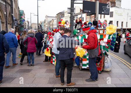 Merchandise vendor in Cardiff on match day: final day of the Six Nations 2019 - Stock Image