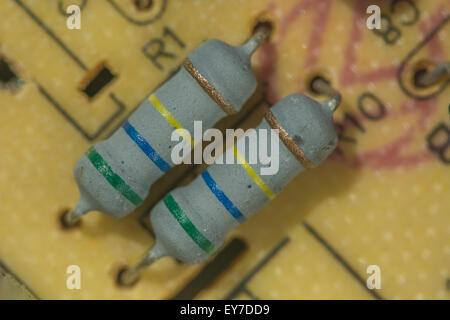 Macro-photo of ceramic resistors on a printed circuit board (PCB). - Stock Image