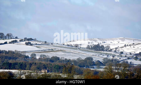 Derbyshire, UK. 13th Jan, 2017. UK Weather: Snow on the hills in the Derbyshire countryside near Ashbourne Peak - Stock Image