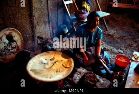 An indigenous Mayan Tzotzil woman makes tortillas in the same way her ancestors did hundreds of years ago. Chiapas State, Mexico. - Stock Image
