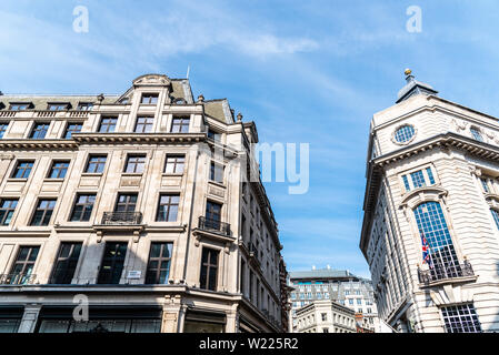 London, UK - May 15, 2019: Low angle view of old buildings in Regent Street in London against blue sky - Stock Image