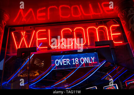 Soho Chinatown slot machine casino gambling arcade with red neon WELCOME sign at entrance 'over 18 only' Soho London UK - Stock Image