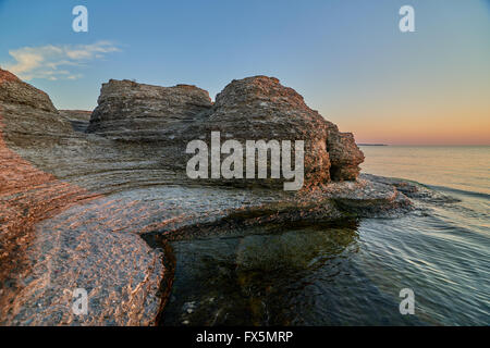 Byrums Raukar, Oeland, Sweden, spectacular tower formation created by limestone eroded of water, sunny evening with - Stock Image