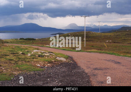 A view from Polbain, Scotland, over the sea and Summer Isles to the Torridon mountain range and Skye mountains in the distance - Stock Image