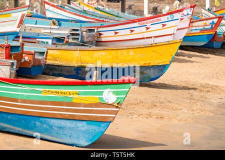 Horizontal view of colourful fishing boats at Vizhinjam in Kerala, India. - Stock Image