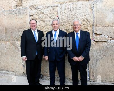 U.S. Secretary of State Mike Pompeo, left, tours the Western Wall and Tunnels with Israeli Prime Minister Benjamin Netanyahu, center, and U.S. Ambassador David Friedman March 21, 2019 in Jerusalem, Israel. - Stock Image