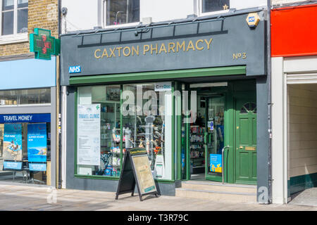 A branch of Caxton Pharmacy in Bromley, South London. - Stock Image
