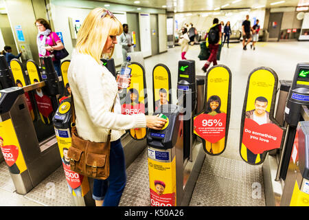London underground, Using contactless card on London underground, using London underground, Contactless card to pay, using contactless card to pay - Stock Image