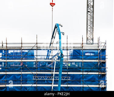 Gosford, New South Wales, Australia - September 3. 2018: Construction and building progress update 123.  Pumping concrete on new home units building s - Stock Image