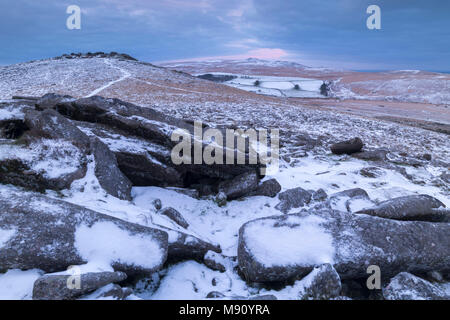 Snow dusted moorland landscape at Belstone Tor, Dartmoor National Park, Devon, England. Winter (December) 2017. - Stock Image