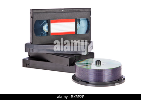 Old Video Cassette tapes with DVD discs isolated on white background - Stock Image